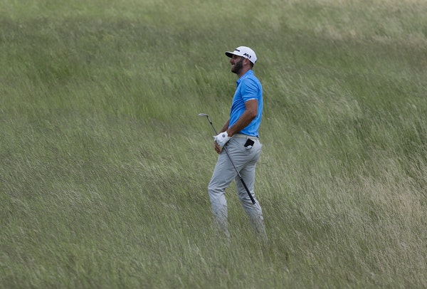 Dustin Johnson hits from some tall fescue on the 12th hole during a practice round for the U.S. Open golf tournament Wednesday, June 14, 2017, at Erin