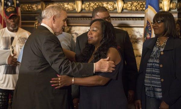 Gov. Mark Dayton embraced Valerie Castile after proposing that a $12 million training fund for law enforcement be named after her son, Philando Castil