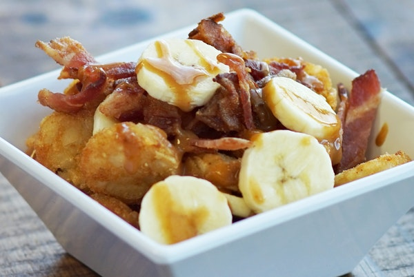One of the new foods coming to the State Fair: Memphis Totchos (sliced bananas and sauteed bacon over tater tots, topped with peanut sauce) at Snack H