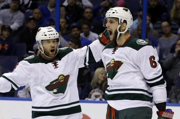 Jason Pominville (left) and Marco Scandella were traded by the Wild to Buffalo. AP Photo/Jeff Roberson