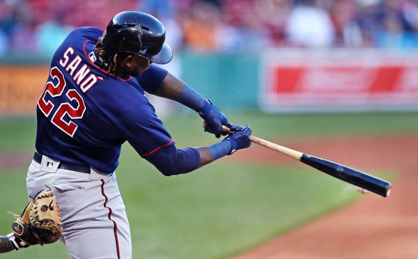 Minnesota Twins' Miguel Sano connects for an RBI double, which drove in Joe Mauer, during the first inning of a baseball game against the Boston Red S