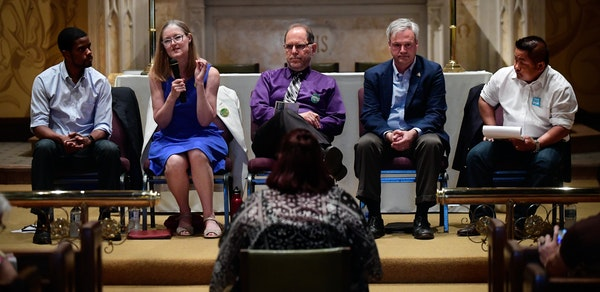 St. Paul mayoral candidates including, from left, Melvin Carter, Elizabeth Dickinson, Tom Goldstein, Pat Harris and Dai Thao, answered a question aske