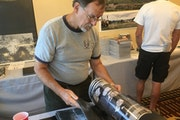 Gary Gentz, 72, of Eustace, Texas, looked through photos from his time with Air America, the CIA-controlled airline used during the Vietnam War.