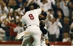 Third baseman Gary Gaetti (8) jumped on closer Jeff Reardon after the final out of Game 7 of the 1987 World Series, as the Twins beat the Cardinals fo