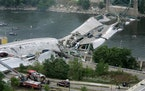 This view shows the Interstate 35W freeway bridge over the Mississippi River after it collapsed Wednesday, Aug. 1, 2007, in Minneapolis, as emergency