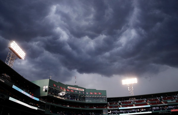 Storm clouds roll over Fenway Park, prior to heavy rain and lightning, prior to baseball game between the Boston Red Sox and Minnesota Twins in Boston