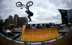 British BMX rider Jamie Bestwick performed a tail whip as he launched out of the vert ramp during practice Thursday afternoon outside US Bank Stadium
