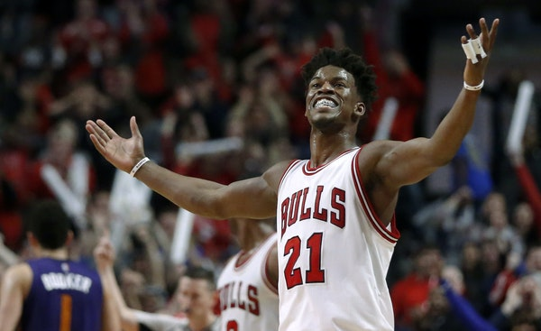 Chicago Bulls' Jimmy Butler (21) celebrates his game-tying shot late in the second half of the team's NBA basketball game against the Phoenix Suns on