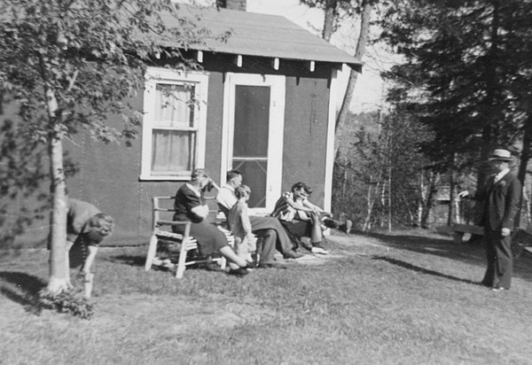 A family gathering at the cabin on Shallow Lake in the early 1940s.
