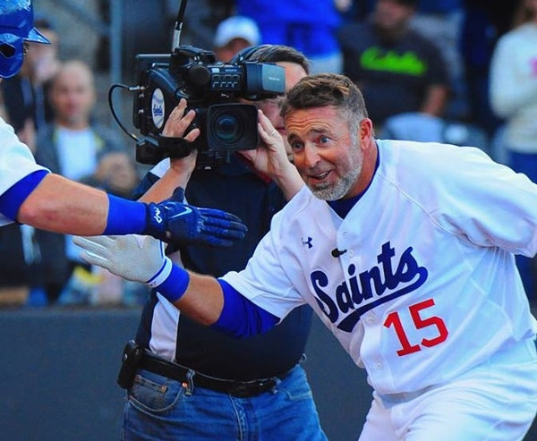 Kevin Millar is greeted at home plate Saturday night.