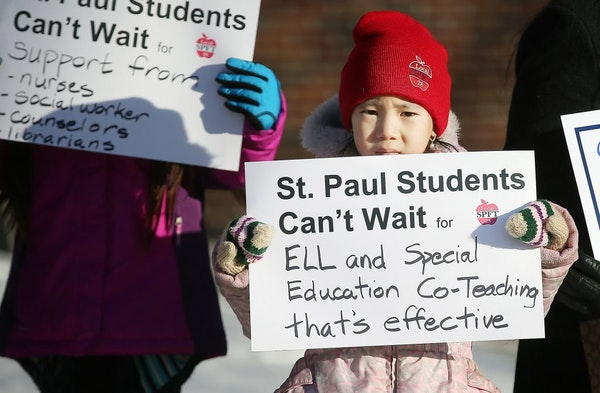 Gaoshiaxa Cha, 7, stood alongside her mother Maysy Ly-Lo, an ELL educational assistant, to support the St. Paul teachers union as they gathered at the