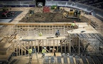 Construction crew worked on assembling different courses for the upcoming X Games held at US Bank Stadium.