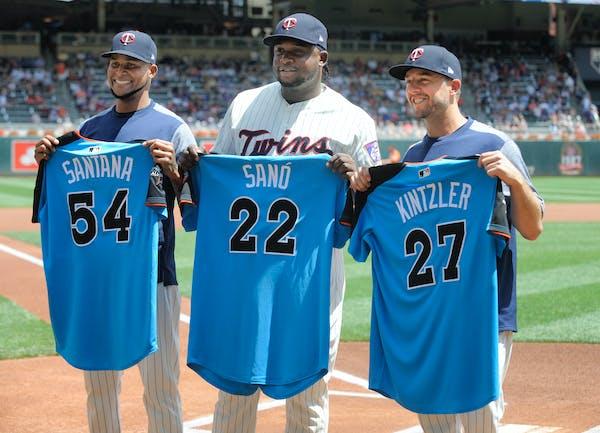 Minnesota Twins' Ervin Santana (54), Miguel Sano (22) and Brandon Kintzler (27) hold their American League All-Star jerseys