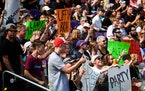 Fans of Rochester's Alec Majerus cheered him on during his second run in the X Games skateboard street qualifiers Friday afternoon.