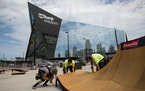 Orlando Lopez, Cesar Lutfi and Daniel Oristanio (from left to right) build a ramp outside of the U.S. Bank Stadium for the X Games, on Sunday. ] COURT