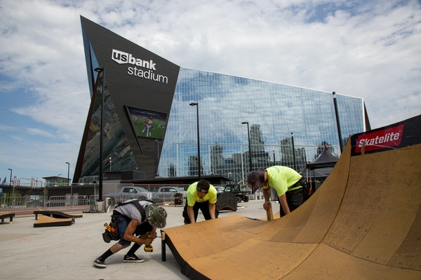 From left, Orlando Lopez, Cesar Lutfi and Daniel Oristanio were building a ramp earlier this week outside of the U.S. Bank Stadium for the X Games.