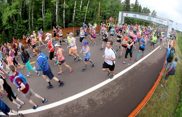 Runners crowd the road at the start of the 2017 Grandma's Marathon on Saturday on the North Shore.