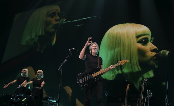 """Roger Waters during """"Time,"""" the third song in his set Wednesday night at Xcel Energy Center in St. Paul. With him were Holly Laessig, left, and Je"""