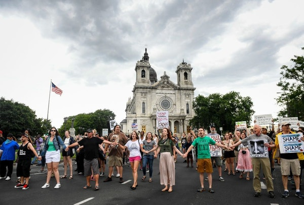Demonstrators left Loring Park in Minneapolis after a rally Saturday and headed to the offramp from Interstate 94 to Hennepin Avenue.
