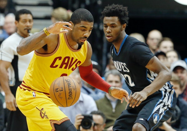 Kyrie Irving, left, watches the ball with Andrew Wiggins in the first quarter of an NBA basketball game, Friday, Jan. 8, 2016, in Minneapolis. (AP Pho