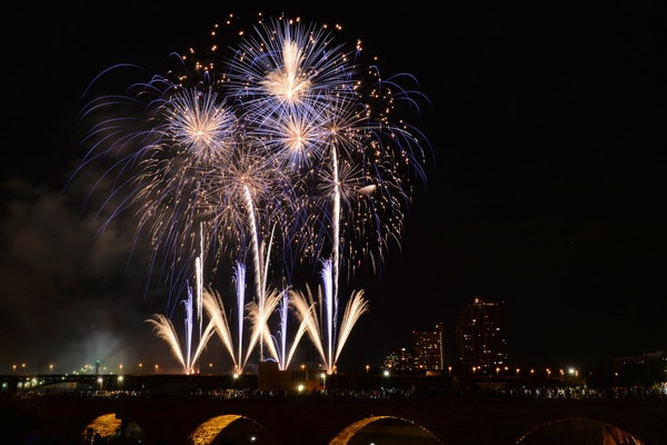 Fireworks exploded over the Stone Arch bridge in Minneapolis.