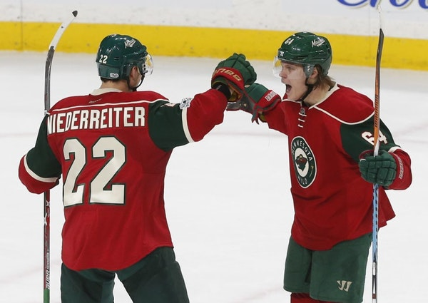 Mikael Granlund, right, celebrates a goal with Nino Neiderreiter last season. Their contracts will determine other moves that Wild general manager Chu