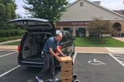 On Thursday, Charlie Rodgers, government records specialist at the Minnesota Historical Society, loaded 12 boxes of records handed over by the Hugo Ci