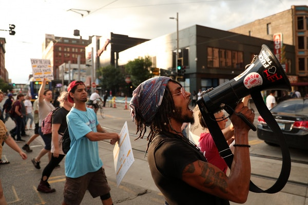 Protesters blocked traffic in downtown Minneapolis as they marched from Loring Park to City Hall on Friday night.