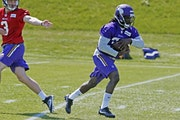 Minnesota Vikings rookie running back Dalvin Cook, right, takes a handoff from quarterback Wes Lunt during the NFL football team's rookies minicamp Fr