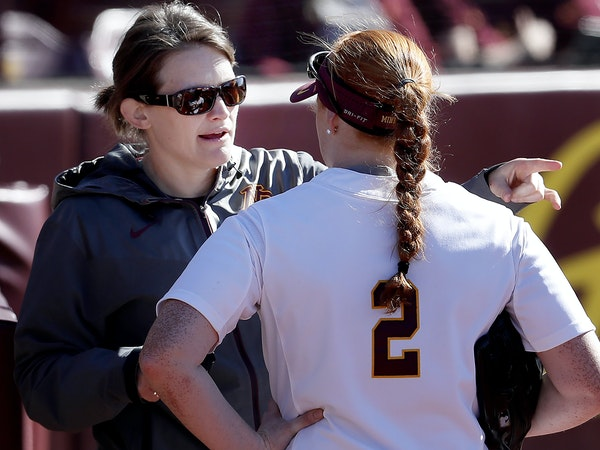 Gophers head coach Jessica Allister spoke with Dani Wagner (2) between innings of a game. Allister was 27 when she was hired at Minnesota.