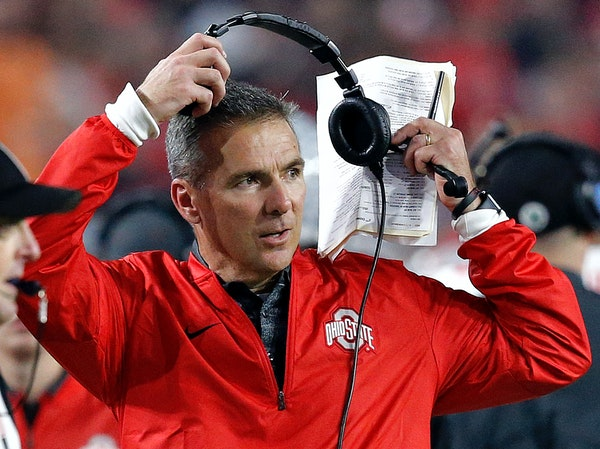 Ohio State head coach Urban Meyer takes off his headset during the second half of the Fiesta Bowl against Clemson