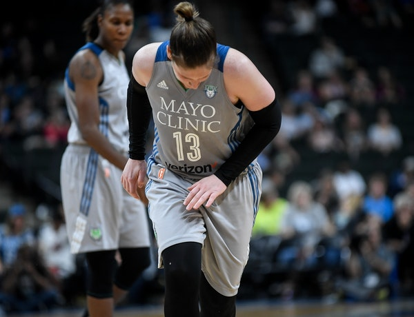 Minnesota Lynx guard Lindsay Whalen (13) winced in pain after injuring her left hand in the third quarter.