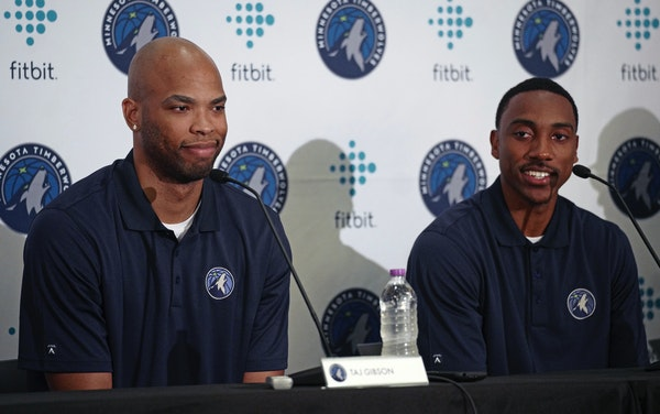 New Minnesota Timberwolves team members Taj Gibson, left, and Jeff Teague, right, sit together in Minneapolis, Monday, July 10, 2017. (Richard Tsong-T