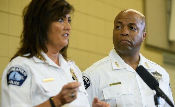 Assistant Chief Medaria Arradondo, right, listened as Police Chief Janeé Harteau spoke to the media on Thursday.