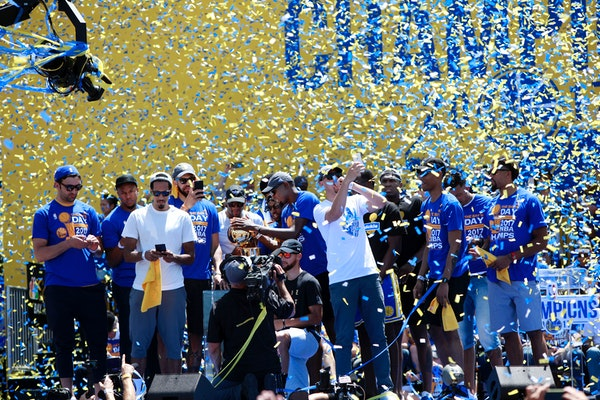 Confetti reins down on the Golden State Warriors 2017 championship team at the end of their rally Thursday, June 15, 2017 in Oakland, Calif. (Karl Mon