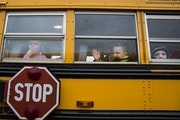 Students sit on the bus at the end of the school day at Eastview Elementary School in Lakeville on Wednesday, November 11, 2015.