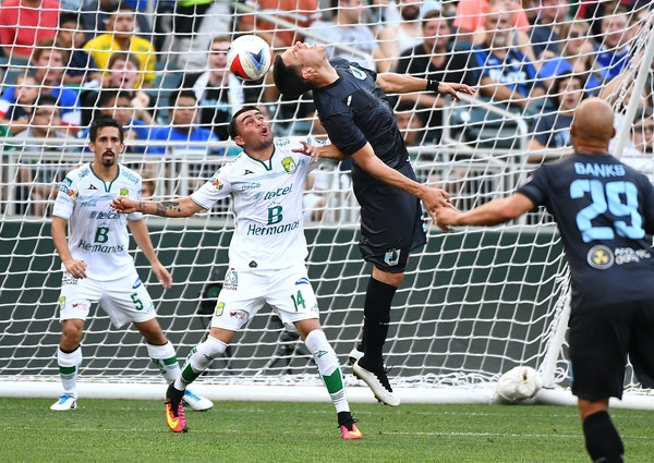 United's Christian Ramirez tried to score on a header last year vs. Club Leon with current teammate Miguel Ibarra on him. The Loons play another Mex