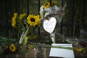 A memorial to Justine Damond is growing on the sidewalk on W. 51st Street in Minneapolis' Fulton neighborhood.
