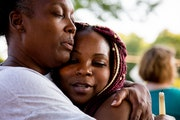 Kenyatta Foster, right, hugged Missy Sims, her father's childhood friend, during a vigil for Kenneth J. Foster. He was killed a week ago when a car dr