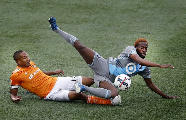 Ricardo Clark (13) and Kevin Molino (18) fought for the ball in the first half.