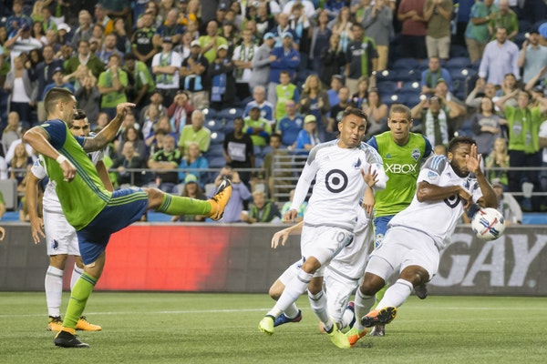 Minnesota United defender Jermaine Taylor, right, committed a handball in the box to award the Sounders a penalty kick in stoppage time, on which Seat
