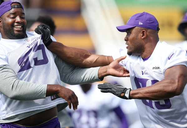 Free-agent acquisition Datone Jones, left, got a taste of new Vikings teammate Danielle Hunter as they worked on line drills in Mankato on July 28. Hu