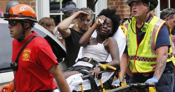 As protesters clash, Va. governor declares emergency