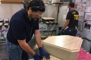 Waconia High School teacher David Aeling worked on a wood cabinet at ELKAY — Medallion Cabinetry plant in Waconia. He is taking part in a teacher wo