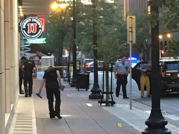 Minneapolis police investigate a shooting downtown Tuesday night near 6th Street and Hennepin Avenue S. that left a bystander wounded.