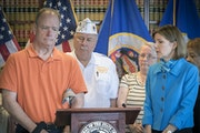 Gulf War veteran Stephen Schmelz told of getting a $2,700 loan that would cost $27,000 of his pension payments. State Attorney General Lori Swanson, r