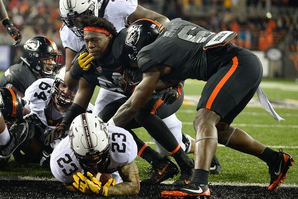 Gophers running back Shannon Brooks broke through Oregon State's defensive line for a touchdown in the third quarter.