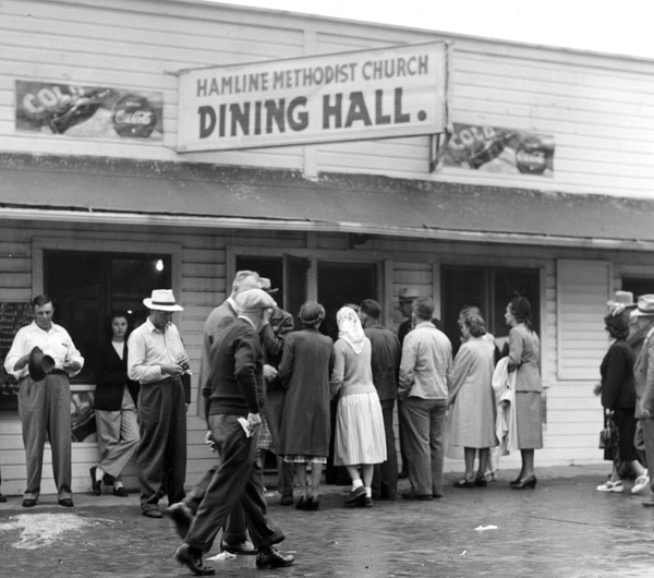 People come and go from the Hamline Methodist Church Dining Hall in 1948.