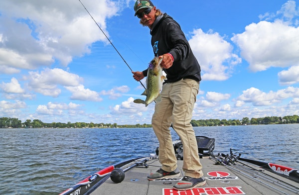 Seth Feider landed a plump largemouth bass while practice fishing on Lake Minnetonka in advance of the big Bassmaster tournament that begins Thursday