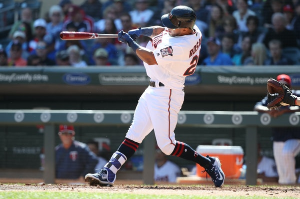 Minnesota Twins left fielder Eddie Rosario follows through with a solo homer in the second inning at Target Field on Sunday